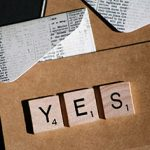 Scrabble letters spelling yes.